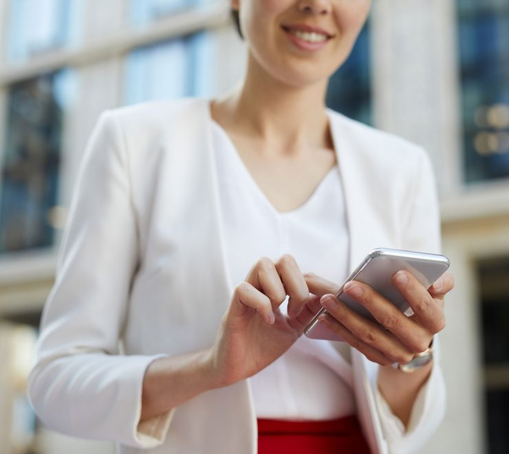 businesswoman-using-smartphone-outdoors-cropped-KAYU7S3.jpg